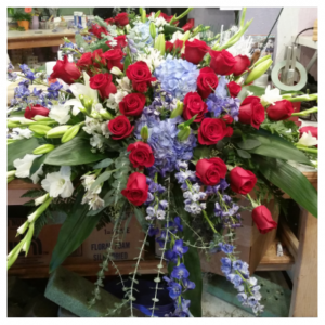 Modern Red, White and Blue Casket Spray by Rosamungthorns
